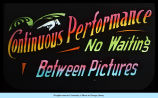 [Sign announcing continuous performances between movie pictures.]