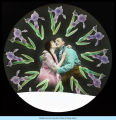 [Picture of an unidentified couple embracing with purple irises encircling them.]