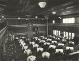 Resturant workers prepare tables at the Swift exhibit during the Century of Progress International Exposition,