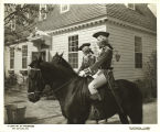 [Women in colonial American military costumes on horseback.