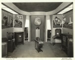 """This display of radio sets, with a background symbolizing radio around the world, in the..."