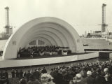 Orchestra performing in the Century of Progress bandshell near Lake Michigan.