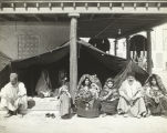 Bedouin family sitting underneath a tent at the Century of Progress Foreign Villages exhibit.