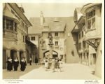 "[Patrons walk through the Swiss Village at the Century of Progress ""Foreign Villages"" exhibition. Three"