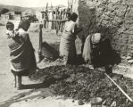 [Women constructing an adobe wall at the Century of Progress Mexican Village.]