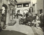 [Street scene at the Century of Progress Mexican Village. Note the pottery on display and the donkey