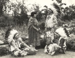 """William P. Wilkerson (Cherokee), president of the Indian Council Fire, confers with Marie..."