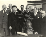 Wiley Post receives the Harmon Trophy for his flight around the world
