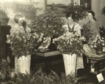 """Left to Right - Berenice Dodd, Hilda Wiegel and Marcella Dodd are shown inspecting a part of the elaborate"