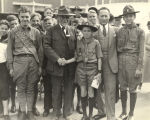 """Uncle Dan Beard, national Boy Scout commissioner, congratulates 14-year old Richard Courtney..."