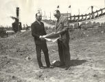 [Photograph of two men standing on the construction site where the Sky Ride was to be built for...