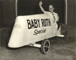 """Baby Ruth Special, an entry in the 'Blue Flame Race' of the All-American Soap Box Derby. Driven by Miss"