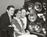 """This is the way it looks from behind. Warren Ashe, Miss Gladys Griswold and John Kane of the..."