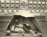 """Pushing his invention, a one-pole tent, all the way from Milwaukee, Wis., Roy Lister arrived..."
