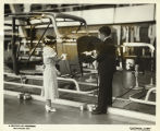 """Miss Gladys Farkes, 27 years old and 47 inches tall, is bossing the job while Victor Bump, 27 years"