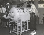 [An early respirator, known as the Iron Lung, on display at A Century of Progress. The Iron Lung was
