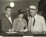 """Congressman Richard J. Welsh, his wife and son, Richard, Jr., of California, sign the official register"
