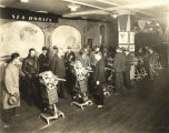 [The Johnson Motor and Boat exhibit. In this photograph, patrons view the company's display of its...
