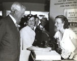 """Miss Jayne C. Walker, pretty Lexington, Ky., World's Fair visitor, was the first to sign the guest register"