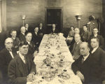 [Photo of general manager Lenox R. Lohr dining with other invited guests at a luncheon. Lohr is seated
