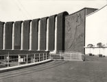 [Exterior view of the Electrical Group exhibition building. The bas relief sculpture on the facade of