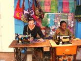 Tanzanian woman teaching me to sew in the market