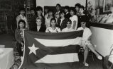 Group portrait of students with Puerto Rican flag