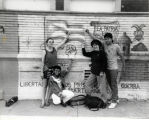 Young people in front of political mural