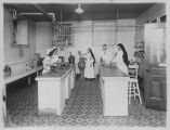 St. Joseph College of Nursing Students and Teachers in a Lab - ca. 1920-1929