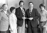 President Dr. John C. Orr receiving a check
