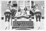 Students sit on Roof of Tower Hall Entrance - ca. 1970-1979
