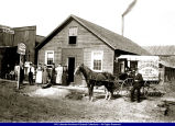 Macomb Steam Laundry and cart circa 1910