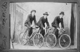 Young Men Posing on Bicycles in Studio in Bushnell