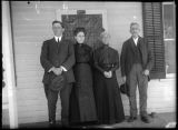 Unidentified Family on Porch in Prairie City