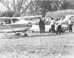 Airplane and Men at Prairie City Airport