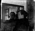 Unidentified Woman at Mirror