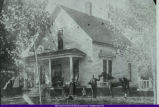 Unidentified Family with Horse outside of House