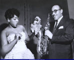 Al Sears and woman with saxophone