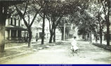 Girl on bicycle at 505 East Jackson Street in Macomb circa 1900